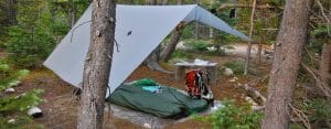 Should You Put a Tarp Over Your Tent? Pros & Cons